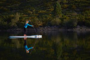 photo of a woman paddle boarding in Vail Colorado