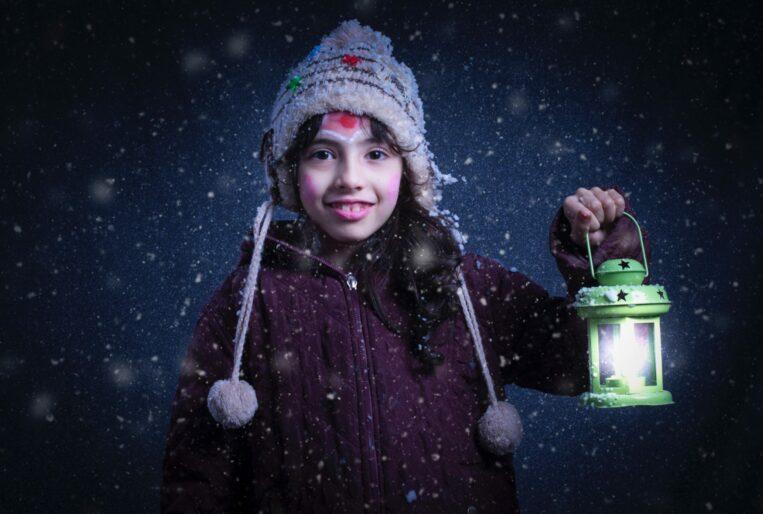 Photo of girl having fun in the snow