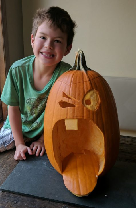 Photo of a kid with pumpkin on Halloween in Vail Colorado