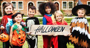 photo of kids in costume saying Happy Halloween