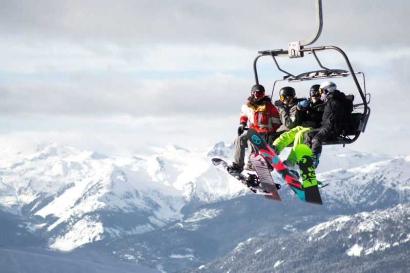 Photo of snowboarders on chairlift