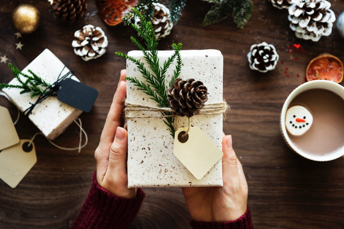 photo of a rustic holiday gift with pinecone