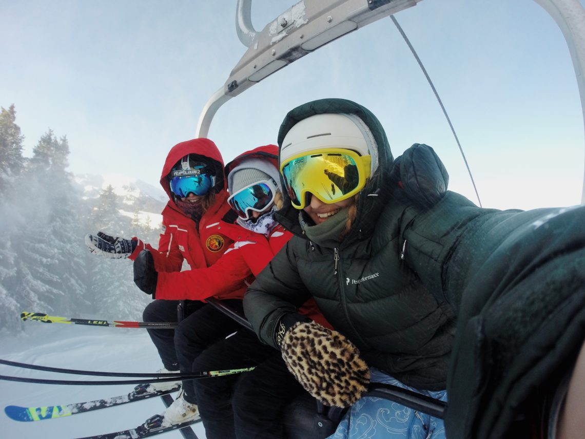photo of three people on a chairlift