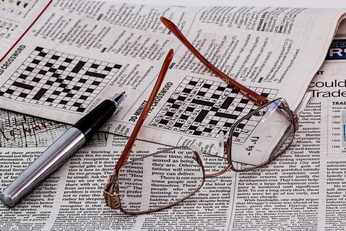 photo of crossword puzzle and glasses
