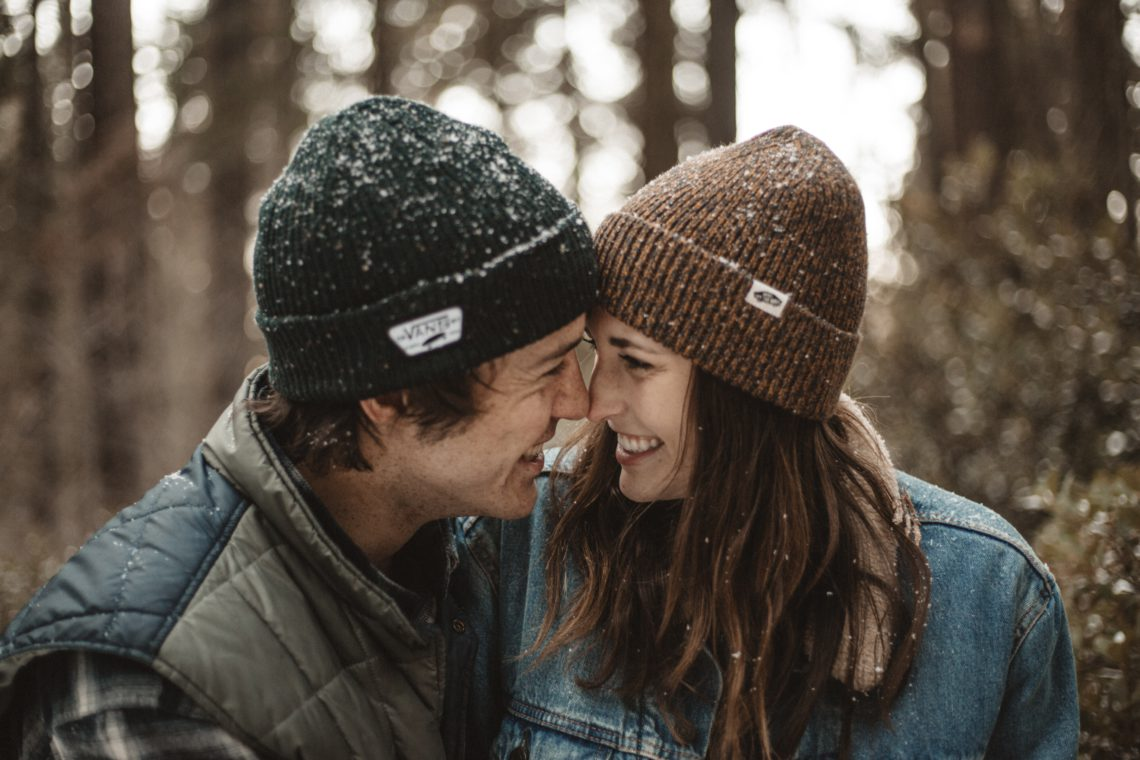 outdoors couple with faces together laughing