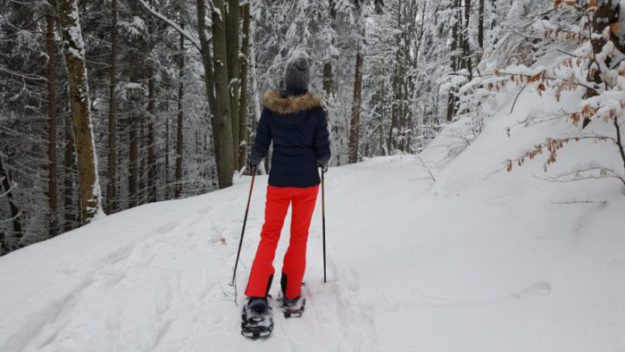 girl snowshoeing
