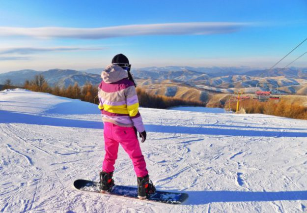 snowboarder wearing pink snow pants