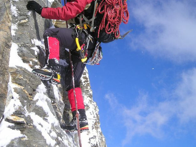 close up of ice climber with equipment