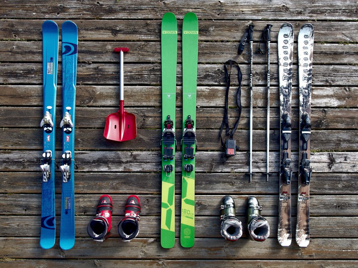 skis laid out waiting for a ski bag