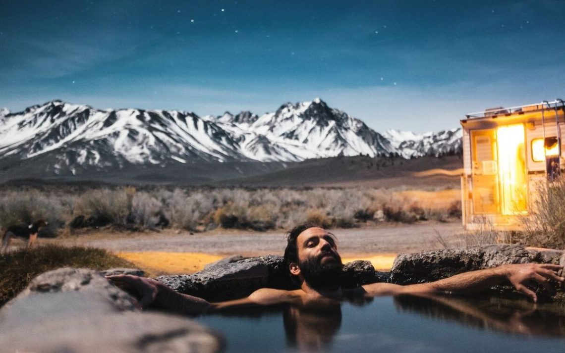 man soaking in a hot spring