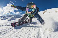 person snowboarding at ski resort