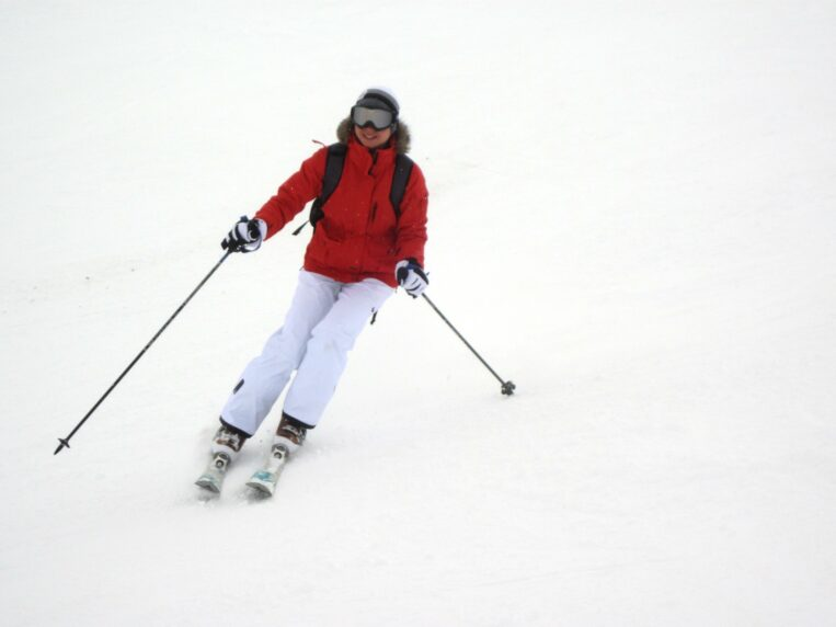 Woman Skiing with Red Ski Jacket