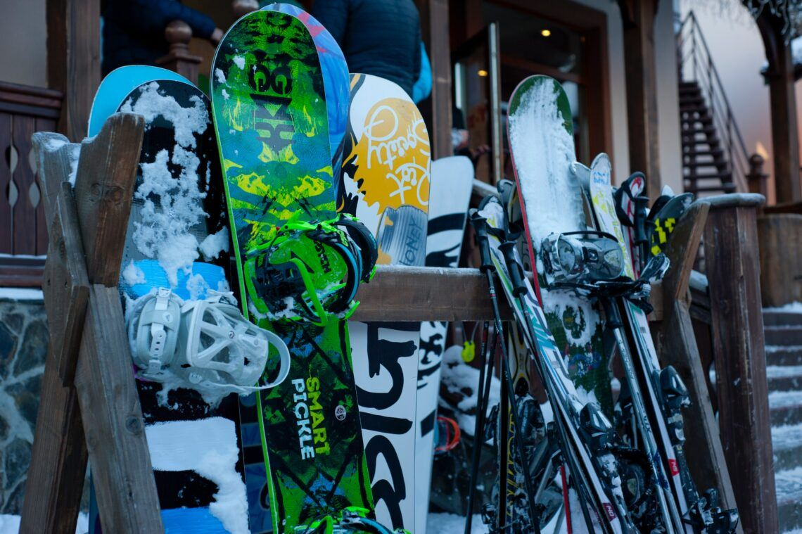 snowboards and skis in rack