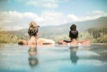 Two women sitting in a hot spring