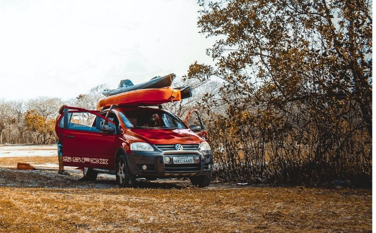 Kayaks secured with tie down straps