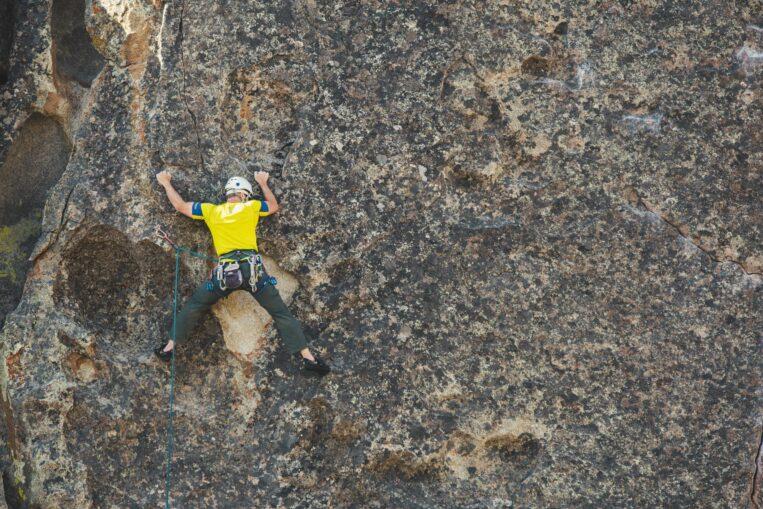 Man Climbing rock wall